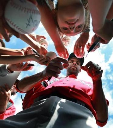 New Red Sox ace David Price lingered after practice, signing autographs and posing for photos with approximately 200 fans.